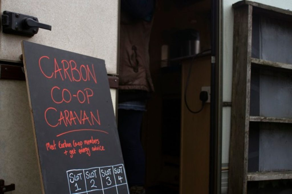 sign carbon co-op caravan