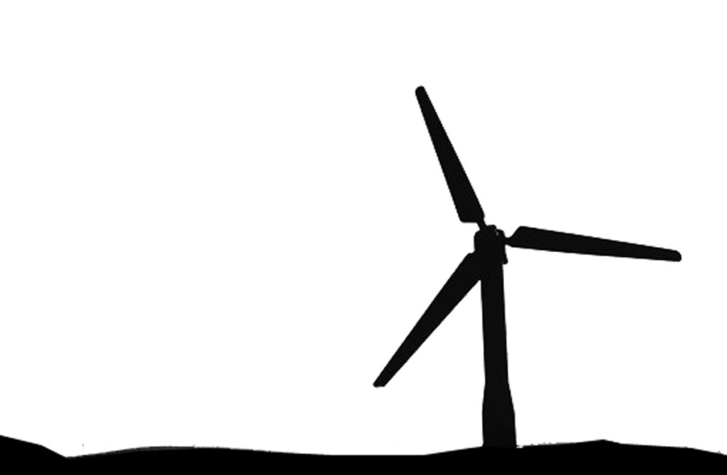 The silhouette of a wind turbine on the horizon