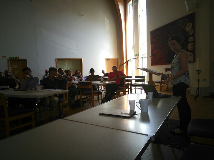 Attendees listening to a presentation by Emma Bridge of Community Energy England