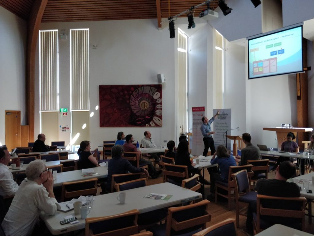 Attendees listening to a presentation by Graham Ayling of Energy Savings Trust