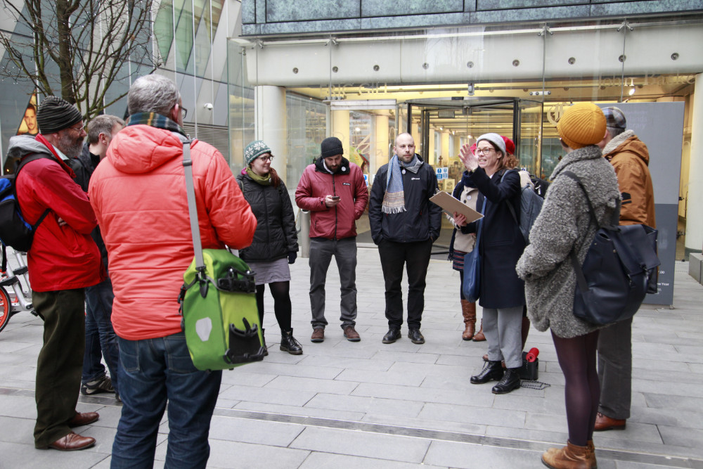 A group of attendees on an energy walk through Manchester city centre