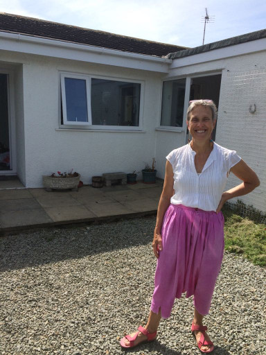 Margaret outside new home in Anglesey